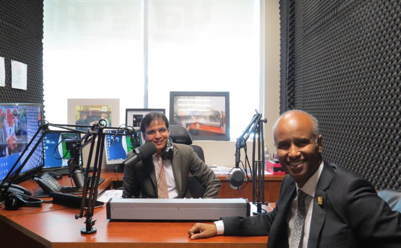 Minister of Immigration, Refugees and Citizenship Ahmed Hussen with Rajinder Saini